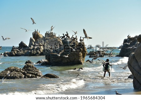 fisherman in the Pacific ocean in Huatulco Oaxaca Mexico is in Central America.   Foto stock ©