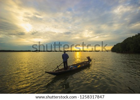 fisherman life and activities on boat in the morning at Amphoe Khlung, Chanthaburi, Thailand  #1258317847