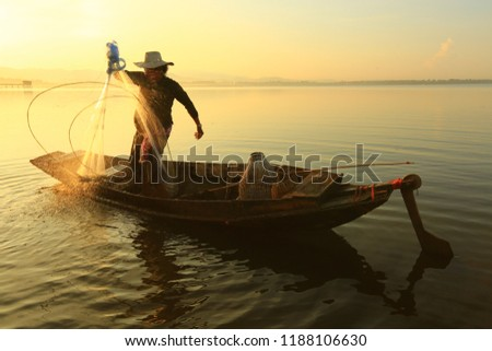 fisherman life and activities on boat in the morning at Bangpra reservoir, Chonburi , Thailand   #1188106630