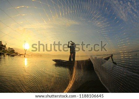 fisherman life and activities on boat in the morning at Bangpra reservoir, Chonburi , Thailand   #1188106645