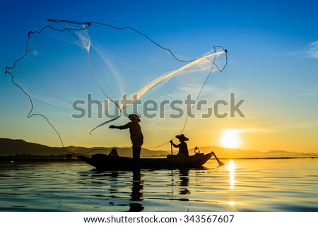 Fisherman of thailand Lake in action when fishing. #343567607