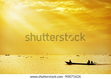 fisherman on boat in morning ,thailand