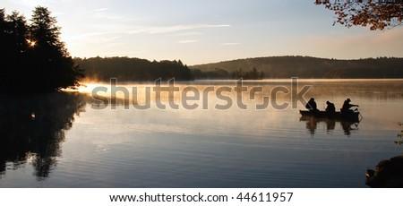 Fisherman on Lake at First Light