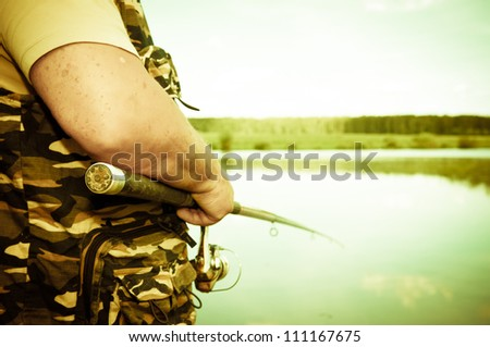 fisherman on river - stock photo