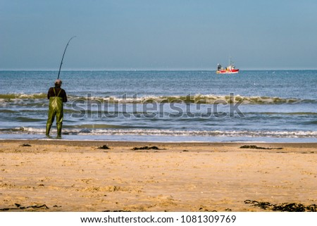 Fisherman on the beach and fisher boat sharing passion #1081309769