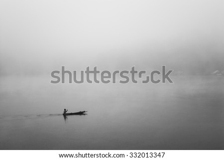 Fisherman on the boat  in the morning foggy Black and White  Color #332013347