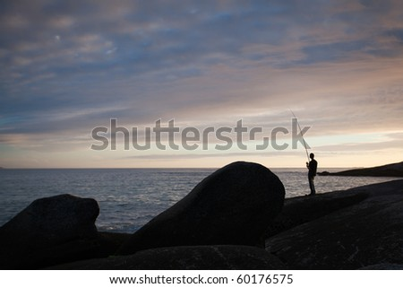 Fisherman on the coast at sunset,