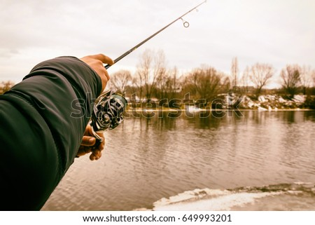 Fisherman on the river bank #649993201