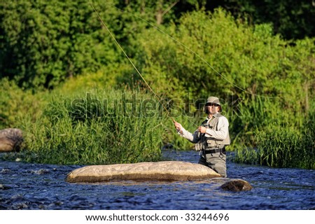 Fisherman on wild river