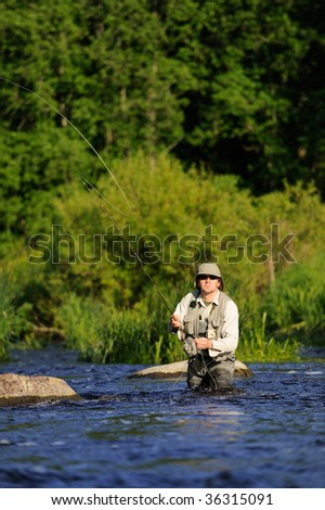 Fisherman on wild river