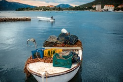 Fisherman's boat with fishing tools on the coast