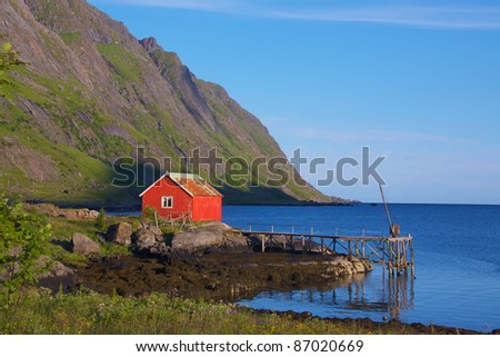 Fisherman's cottage with jetty on Lofoten Islands, Norway