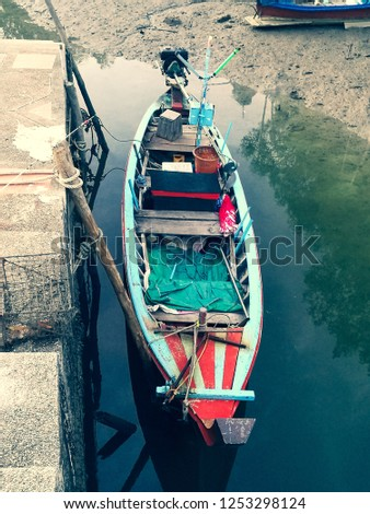 Fisherman's fishing boat picture.In Phuket of Thailand