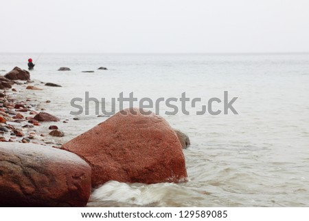 Fisherman Stones in sea water autumn sea in Orlowo, Gdynia Poland