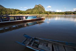 Fishermen and fishing boats on the Mekong River in Laos