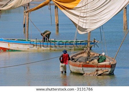 Fishermen and their traditional sail boats (dhows), Vilanculos coastal sanctuary, Mozambique