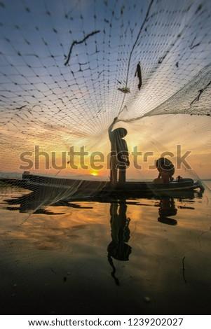 Fishermen are catching fish #1239202027
