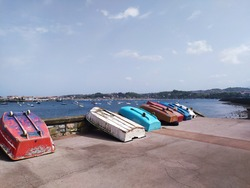 fishermen boats of different colors in the port of Hondarribia, a coastal town in the Basque Country