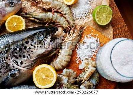 Fishermen brought in an expensive fish restaurant carcass fresh salmon and tiger prawns, cook restaurant immediately started to marinate seafood for future cooking