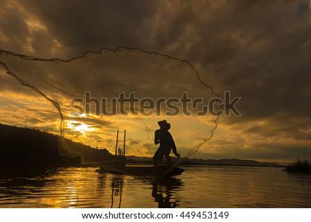 Fishermen fishing at sunrise. #449453149