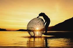 Fishermen fishing in the early morning golden light,fisherman fishing in Mekong River,Thailand,Vietnam,myanmar,Laos
