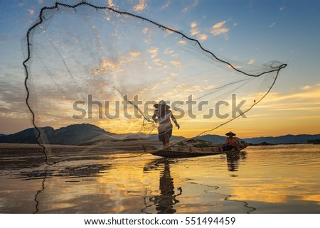 Fishermen fishing in the early morning golden light,fisherman fishing in the river,Thailand,Vietnam,myanmar,Laos,Asian #551494459