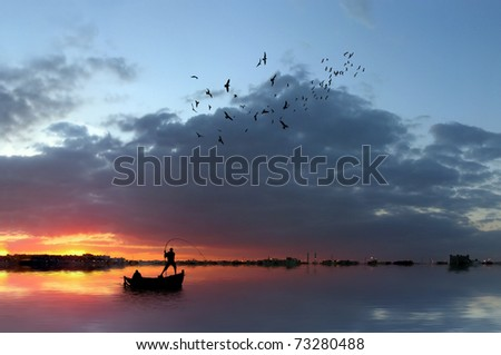 Fishermen in a boat at sunset