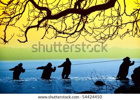 Fishermen in the water - stock photo