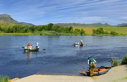 Fishermen on the Missouri River near Wolf Creek Bridge on Old U.S. Highway 91, Montana, USA