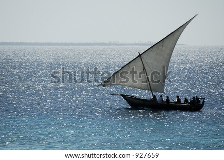 Fishermen returning from work at midday on Zanzibar Island off the coast of Tanzania, Africa