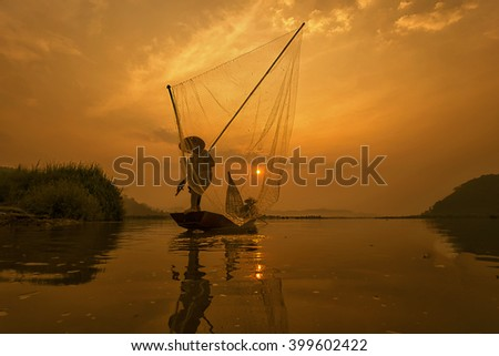 Fishermen when fishing in the mekong river , Thailand