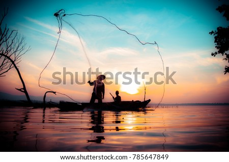 Fishermen who are fishing in the river and a silhouette #785647849