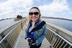 Fisheye lens view - female tourist explores the boardwalks of Assateague Island National Seashore in Delmarva Maryland