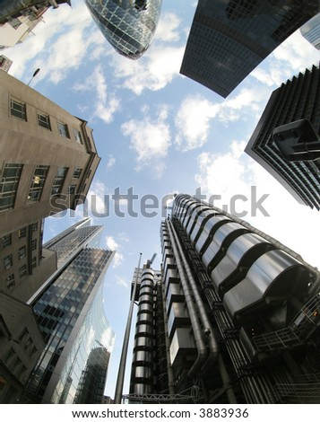 fisheye of swiss re and lloyds buildings in london with sky