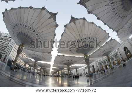 Fisheye view of giant umbrellas at Masjid Nabawi (Mosque) compound in Medina, Kingdom of Saudi Arabia. Nabawi mosque is the second holiest mosque in Islam. - stock photo