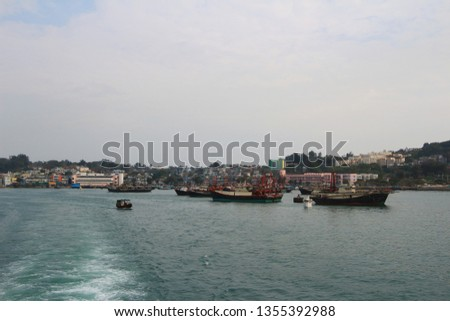 Fishing and house boats anchored in Cheung Chau harbour. Hong Kong. #1355392988