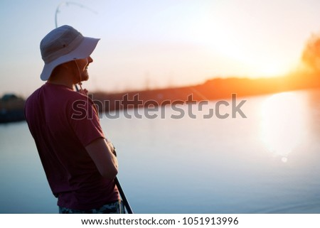 Fishing as recreation and sports displayed by fisherman at lake #1051913996
