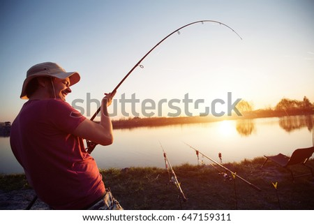 Fishing as recreation and sports displayed by fisherman at lake #647159311