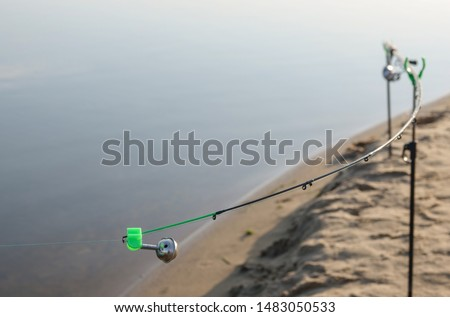 Fishing bell at the end of a fishing rod. Bells will ring when the fish is hooked. #1483050533