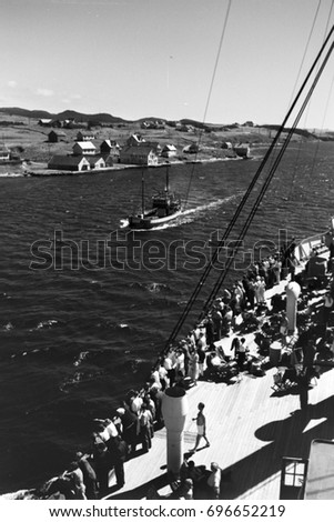 fishing boat and crowd waiting...