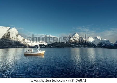 fishing boat and Reine Village, Lofoten Islands, Norway