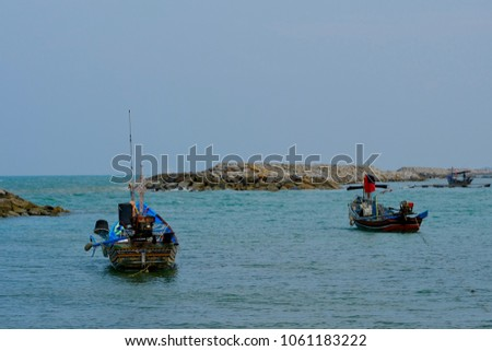 "Fishing Boat and Rocky breakwater offshore of ""BO IT BEACH"" Ko Taeo,Songkhla province,Thailand.  #1061183222"