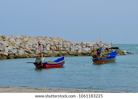 "Fishing Boat and Rocky breakwater offshore of ""BO IT BEACH"" Ko Taeo,Songkhla province,Thailand.  #1061183225"