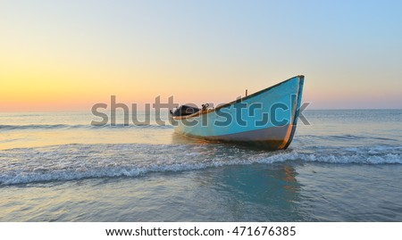 Fishing boat and sunrise on Black Sea