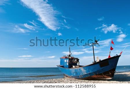 Fishing boat at baltic sea coast
