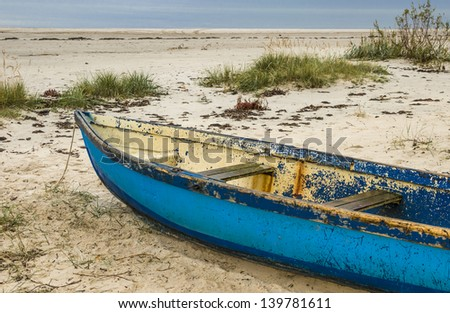 Fishing boat at sandy beach near of fishermen village, Baltic Sea, Latvia, Europe