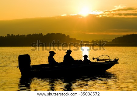 Fishing Boat at Sunrise - stock photo