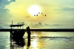 Fishing Boat at Sunrise with bird flying around