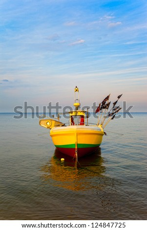 Fishing boat at the beach in Sopot, Poland. - stock photo