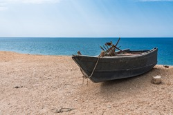 Fishing boat by the sea